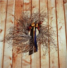 modern wreath with ribbon and berries