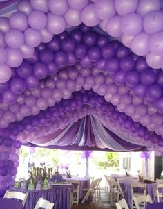 Purple party ceiling of balloons.