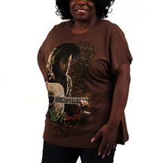 """This chocolate Bob Marley Plus Size Women'sTee showcases Bob Marley playing the guitar with the lyrics """"Is This Love that I'm Feeling"""" printed in the background. Bob Marley's signature is printed in rasta color script at the bottom."""