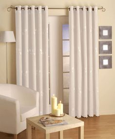 Like the design - monochromatic, tight spacing of mirrors, lamp & chair. Also, curtains for sliding glass door