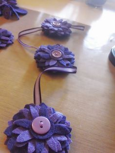 I love making these sweet little felt flowers.  I've used several to make a hanging garland.
