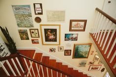 Gallery wall over a staircase in Lauren McCaul's Alabama Home #theeverygirl #interior #gallery