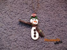 Tutorial :Wooden Spoon Snowman. You will need: wooden spoon, white paint, markers, small button, scrap of fabric piece of cord. Paint spoon white. color in the face and hat of the snowman. Hot glue small buttons on snowman's front (on top of hat, too, if wanted) and tie small scrap of fabric around his neck; glue. Hot glue a loop of cord on the back to be able to hang your creation on the tree.
