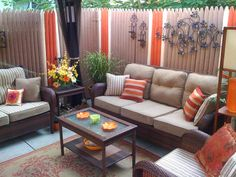 RMSer ozymndius created a cozy, fun and relaxing space in this small urban patio, painting the fence in warm hues that complement the cushions.