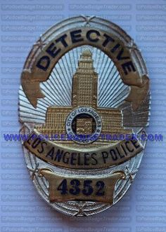 LAPD Los Angeles Police (Series 6) Detective badge . Attachment: Rear pin and roller. Hallmark: 12-08. Available at www.policebadgetrader.com