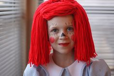 DIY Raggedy Ann Costume. Dress from Goodwill. Yarn wig made at home. Add striped tights and apron by Design Mom