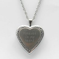 Two-Tone Silver Heart Locket Necklace Have their name engraved on the front and a few special words or date on the back for a personal touch. #personalize #gifts