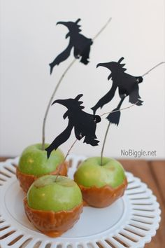Halloween Silhouettes (FREE Download)  I love the idea of candy- or caramel-covered apples in a Wizard of Oz party (those pesky apple trees!), but especially with these wicked witch silhouettes, which you can download and print for free.   See more at NoBiggie