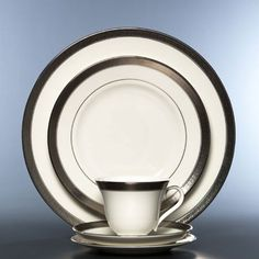 Simple white place settings allow holiday dishes to show their true colors. We love the platinum ring around these!