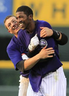 Dexter Fowler and Tulo celebrate after an extra-inning win over the Dodgers