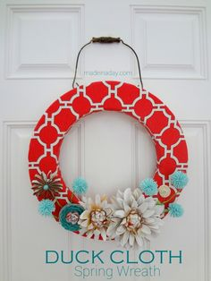 Spring Wreath~ Duck Cloth Flat Pattern Style - Made in a Day. Love the color combo for spring. She uses paper towel roll and spray painted flowers for embellishments
