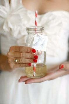Champagne, glass jar, paper straw. Just what every girl needs!