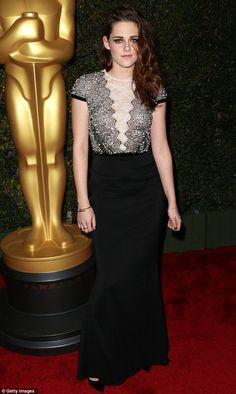 Bewiching: The Twilight actress looked fabulous in a high-waisted fish tail skirt and black and white lace top