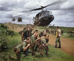 The first helicopter war; Viet Nam!Australian soldiers waiting to be picked up by US Army helicopters after the completion of Operation Ulmarra, the cordon and search of the village of Phuoc Hai.  Phuoc Hai, South Vietnam - August 26, 1967.  Source