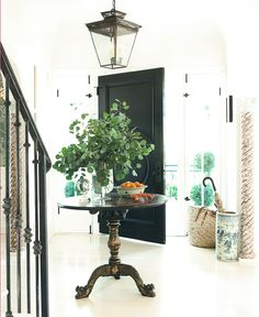 Mark D. Sikes, House Beautiful: entry, black door, chinoiserie table, basket