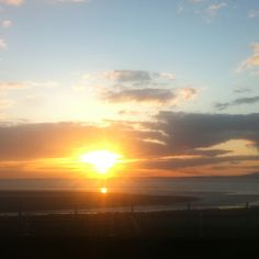 Sun setting over Morecambe Bay from the restaurant at the Midland Hotel.