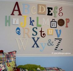 Great for playroom. I could decorate each letter differently. get letters at michaels or joannes. use fabric or paint, or contact paper