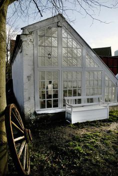 white green house with salvaged windows