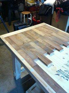 DIY wood plank kitchen table picture step by step ~ would also be really really awesome for kitchen counters!!!  Stained black with high gloss protectant over them..... Hummmm.....