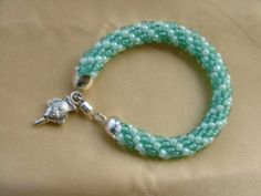 Seafoam and clear swirl Kumihimo bracelet with Silver Clasp and fish charm on Etsy, $22.00