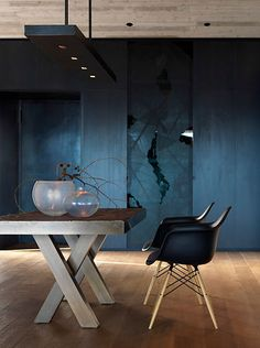 This table is very nice. It is wooden and big to work on as well as for decorations when not in use. It is a nice rustic piece to this room as well gives it an organic feel.