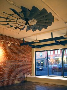When Tiger Crafts moved their brick & mortar store they also changed up some of the store decor. Check out this really interesting use of a refurbished windmill parts. These windmill blades are being used as a store ceiling fan - really amazing!