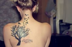Tattoo of a tree with birds on upper back
