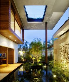 Meera House - a luxurious earthen-roof house, interior view with water garden feature