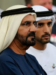 Sheikh Mohammed bin Rashid Al Maktoum (L), Ruler of Dubai and Vice President of the UAE and Sheikh Hamdan bin Mohammed bin Rashid Al Maktoum (R) , Crown Prince of Dubai during the Dubai World Cup on 29.03. 2014 in Dubai, UAE.