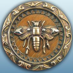 Antique brass bee button with wood background  cut steels. bee button, wood background, antiqu brass, bee reveri, bug, wood bee, background cut, brass bee