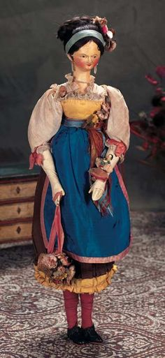 Tiny Grodnertal Wooden Doll with Sculpted Tuck Comb.  I think this is the original description: Outstanding Grodnertal Wooden Doll with Original Costume