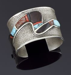 Cuff | Edison Cummings.  Sterling silver inlayed with Kingman turquoise, ironwood, coral, ivory and dinosaur bone.