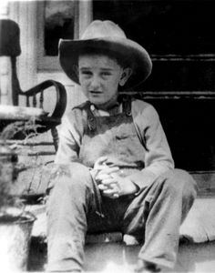 A picture of Lyndon Johnson in 1915 at his family home in the Texas hill country near Stonewall, Texas and Johnson City.