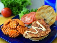 Summertime grilled chicken sandwich with an easy to make red jalapeno and chive sauce.