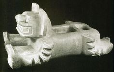 Sode view of an onyx jaguar sculpture from Teotihuacan, possibly a ritual container to receive sacrificed human hearts.