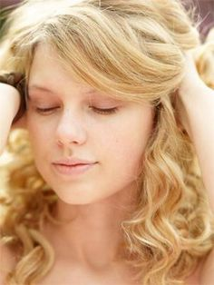 Taylor Swift with no makeup.  Still adorable