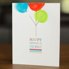 Using this free printable make a happy birthday balloon card with watercolor paint