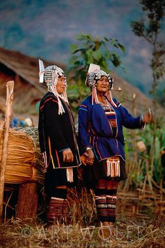 Asia | Portrait of two Akha women wearing traditional clothes, Thailand