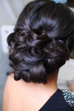 up-do hairstyle ideal for a glamorous wedding. Reminds me of a Catherine Zeeta Jones look
