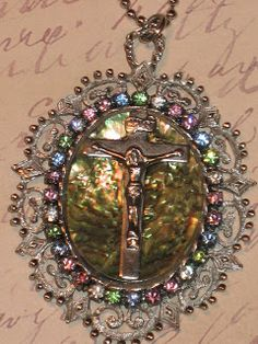 abalone with a cross surrounded by rhinestones :-)