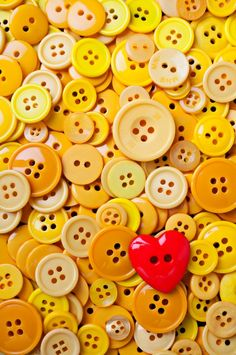 Red heart and yellow buttons by:  photogarry