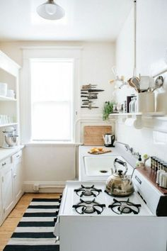 Cute kitchen with a stripe rug