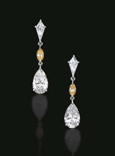 A PAIR OF DIAMOND AND COLORED DIAMOND EAR PENDANTS  Each pear-shaped diamond pendant, suspended by a marquise-cut yellow diamond, from a kite-shaped diamond surmount, mounted in platinum The yellow diamonds have not been tested for natural color origin  The total weight of the pear-shaped diamonds is approximately 4.00 carats