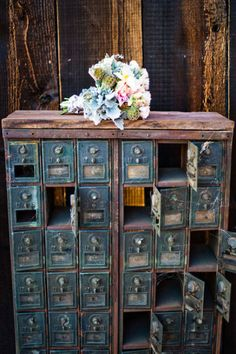 Vintage mailbox? Fun for guest favors, mini- phot frames, or a fun way to write the couple letters of love, put it in the mailbox.