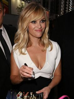 Reese Witherspoon displaying maximum cleavage in a low cut dress outside the Glenn Gould Theatre in Toronto