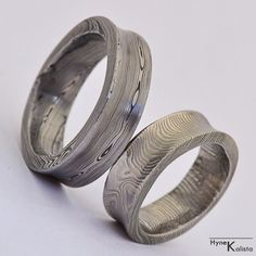 Custom Wedding Ring -  Hand forged concaved damascus wedding ring - Collium. $180.00, via Etsy.