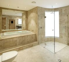 This is how I want my shower.  Frameless doors and no lip to step over.