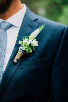green and white boutonniere, photo by Lev Kuperman http://ruffledblog.com/kaaterskill-ny-wedding #weddingideas #groom