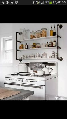 Love this shelving over the stove.