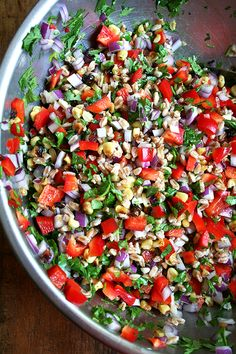 Summer farro salad with roasted corn, diced red onion, red bell pepper and cilantro